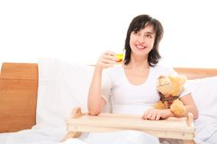 Happy dreamy woman in bed Royalty Free Stock Photos