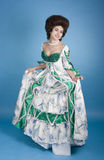 Happy about the dress. Beautiful 18th century happy lady wearing vintage fashion dress Royalty Free Stock Photography
