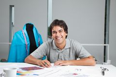 Happy Dressmaker At Workshop Stock Image