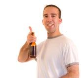 Happy Drinker. A happy man driniking a bottle of beer Stock Photos