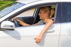 Happy driver. Young woman in her car with a seat belt Royalty Free Stock Photos
