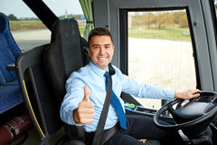 Happy driver driving bus and snowing thumbs up Royalty Free Stock Images