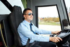 Happy driver driving intercity bus stock images