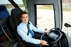 Happy driver driving intercity bus Royalty Free Stock Images