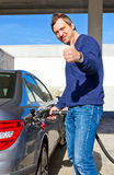 Happy driver on a fuel station Royalty Free Stock Images