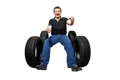 Happy driver with new tires. Isolated on white background Stock Photography