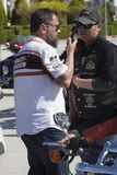 Happy driver riding Harley Davidson. Antalya, Turkey - May 21, 2017: Antalya, Harley Davidson motor convoys on the road. Festival name is Antalya Rally, Demo Stock Photo
