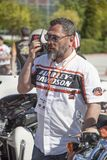 Happy driver riding Harley Davidson. Antalya, Turkey - May 21, 2017: Antalya, Harley Davidson motor convoys on the road. Festival name is Antalya Rally, Demo Stock Photography