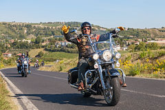 Happy driver riding Harley Davidson Royalty Free Stock Photo