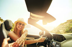 Happy driver touching hand of passenger Royalty Free Stock Photos