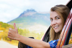 Happy driver woman shows thumb up Royalty Free Stock Photography