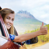 Happy driver woman shows thumb up Royalty Free Stock Photo