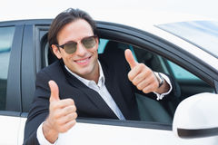 Happy driving businessman with thumbs up Stock Image