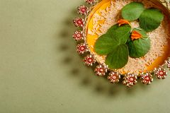 Happy Dussehra greeting card , green leaf. And rice stock images