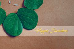 Happy Dussehra greeting card , green leaf. And rice stock photography