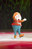 Happy Dwarf. GREEN BAY, WI - MARCH 10: Happy Dwarf from Snow White in skates at the Disney on Ice Treasure Trove show at the Resch Center on March 10, 2012 in Stock Image