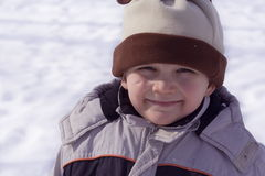 Happy dwarf. Young boy on snow royalty free stock photo