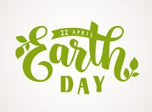 Happy Earth Day. 22 april. Vector hand lettering greeting text with green leaves silhouette. Earth Day. 22 april. Vector hand lettering text Stock Photos
