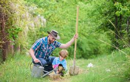 Happy earth day. Family tree nursering. watering can, pot and shovel. Garden equipment. Eco farm. small boy child help. Father in farming. father and son in royalty free stock photos