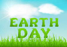 Happy Earth Day greeting card. Nature background with green  grass on blurred soft background. Royalty Free Stock Photos