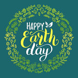 Happy Earth Day hand lettering background. Vector illustration with floral frame for greeting card, poster etc. Stock Photos