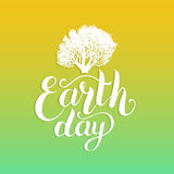 Happy Earth Day hand lettering background. Vector illustration with tree silhouette for greeting card, poster etc. Royalty Free Stock Photos