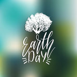 Happy Earth Day hand lettering background. Vector illustration with tree silhouette for greeting card, poster etc. Royalty Free Stock Images