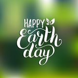 Happy Earth Day hand lettering card on blurred background. Vector illustration with leaves for banner, poster. Happy Earth Day hand lettering card, background Royalty Free Stock Photo