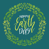Happy Earth Day hand lettering in round floral frame. Vector global holiday illustration for greeting card, poster etc. Happy Earth Day hand lettering in round Stock Photos
