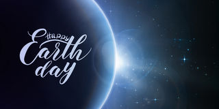 Happy Earth Day lettering on abstract vector blue background with planet and eclipse of sun. Sun shine from the edge of a earth. Sparkles of stars on the royalty free illustration