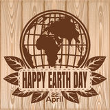 Happy Earth Day lettering on a wooden background. April 22. Vector illustration Royalty Free Stock Photography