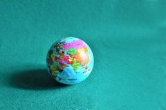 Mock earth globe on green background royalty free stock image