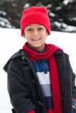 Happy East Indian boy playing in the snow Royalty Free Stock Photography