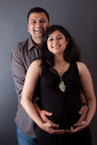 Happy East Indian Husband with his Pregnant wife. An East Indian couple holding the belly of the pregnant wife Stock Photos