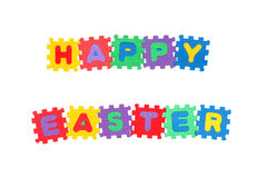 Happy Easter. Message Happy Easter from letter puzzle, isolated on white Stock Photography