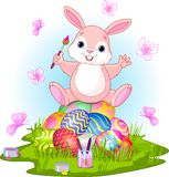 Happy Easter. Illustration of Easter bunny sitting on eggs  and butterflies in a spring theme Stock Image