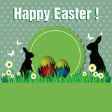 Happy Easter. Abstract colorful background with colored Easter eggs and two bunny silhouettes. Easter concept Stock Image