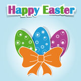Happy Easter. Three multi-colored Easter eggs with the bow and the words Happy Easter Royalty Free Stock Photo
