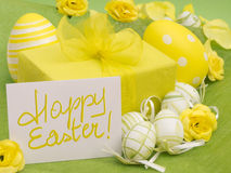 Happy Easter. Concept with card and present royalty free stock image