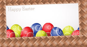 Happy Easter. Wicker easter card (colorful with eggs Stock Photo
