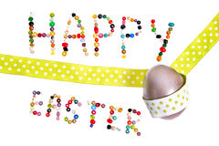 Happy easter. Sign made og pearls decorated with silver egg and green decoration tape Stock Images