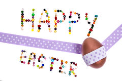 Happy easter. Sign made og pearls decorated with copper egg and decoration tape Stock Image