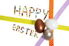 Happy easter. Sign made og pearls decorated with copper, white and silver  egg and decoration tape Royalty Free Stock Images