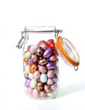 Happy easter!. Glass jar, filled with chocolate easter-eggs Stock Image