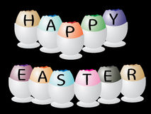 Happy Easter. Message written on coloured eggs Royalty Free Stock Photography