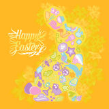 Happy Easter. An abstract yellow bunny rabbit with Easter icons on a yellow background Royalty Free Stock Photo