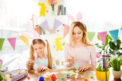 Happy Easter atmosphere! Funny, pretty mummy teaching, training stock images