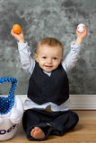 Easter Baby. Excited and happy Baby boy holding up easter eggs Stock Photo
