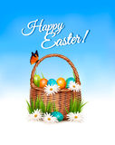 Happy Easter background. Basket with eggs and a butterfly Royalty Free Stock Image
