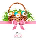 Happy Easter background. Basket with eggs, daisies, grass Royalty Free Stock Photo